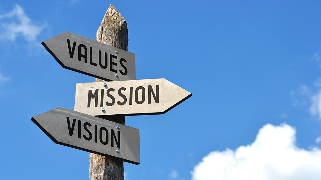 three signs pointing in different directions that read values, mission, mission respectively